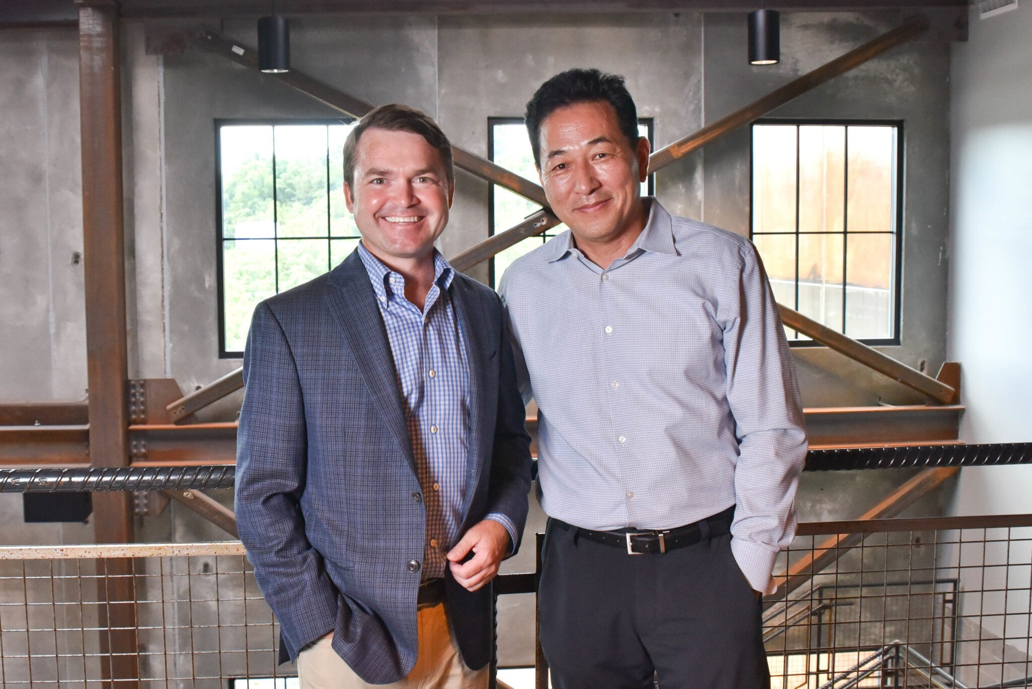 Woo K. 'David' Cheon (CEO) with Will Massey (COO) of NCI Inc.