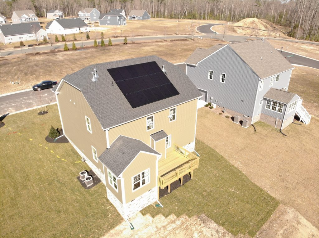 home with solar pv panels on roof